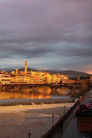 Arno river and Palazzo Vecchio at sunset, Florence, Italy